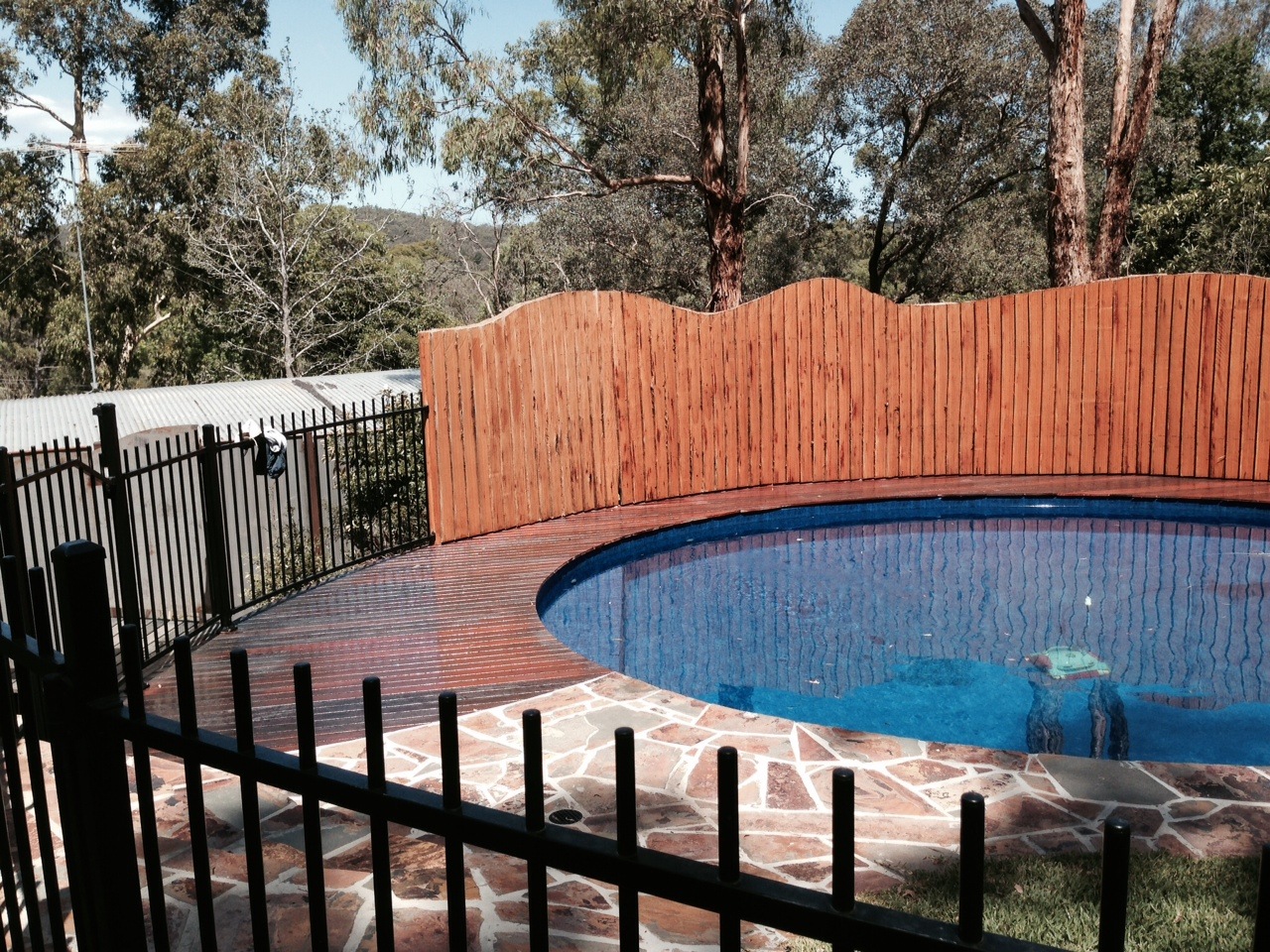 Hardwood decking around pool